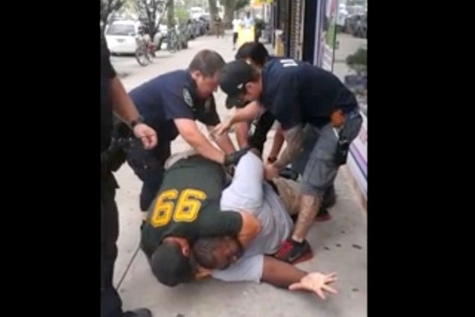 Eric Garner cell phone capture of NYPD holding him down with choke hold. A move banned by NYPD._7477205958272436554