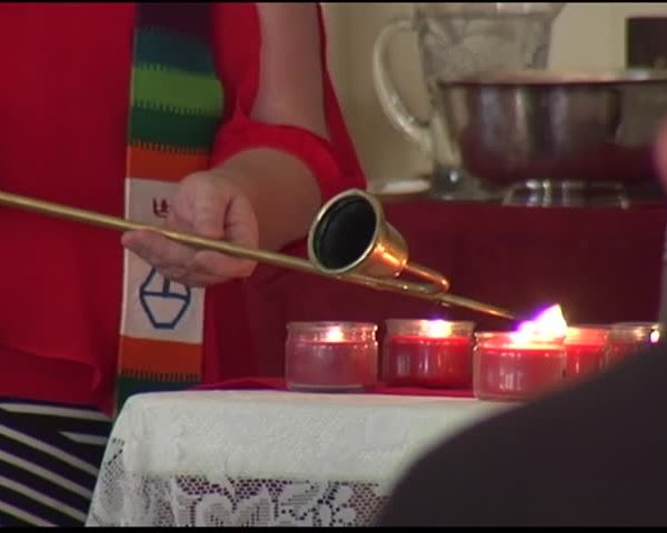 Group Holds Candlelight Vigil for HIV-AIDS Deaths