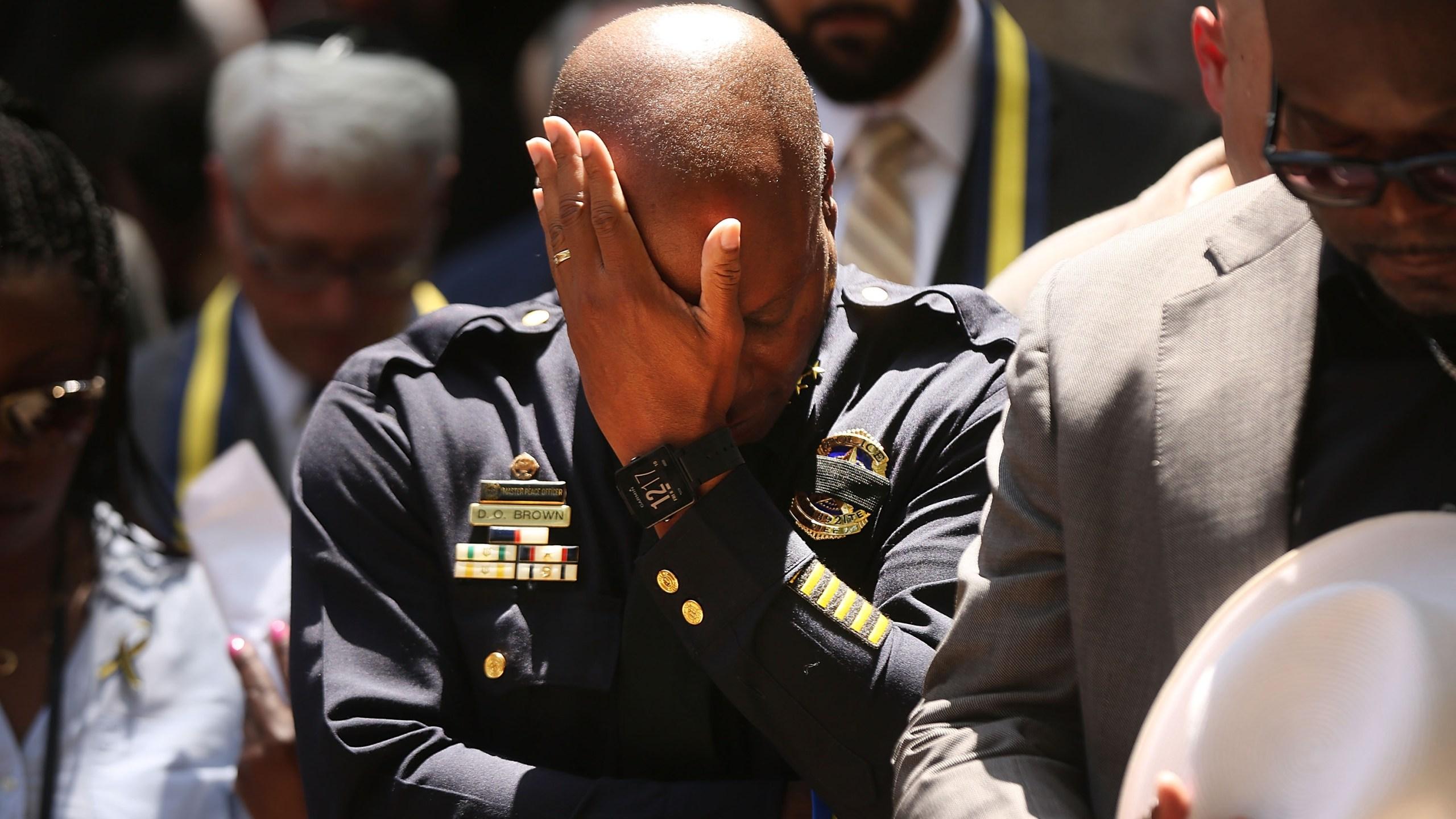 Dallas Police Chief David Brown pauses at a prayer vigil