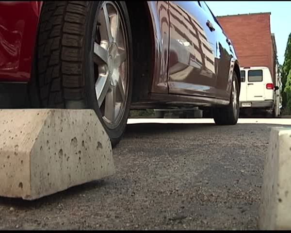 State law at center of downtown towing tussle_06649387