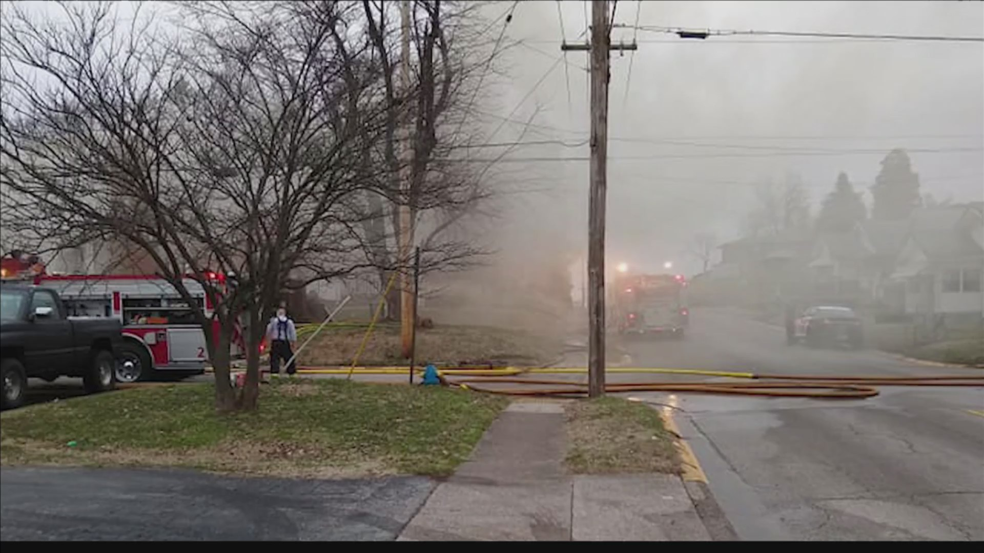 Firefighters battle a house fire on Sunday in Owensboro