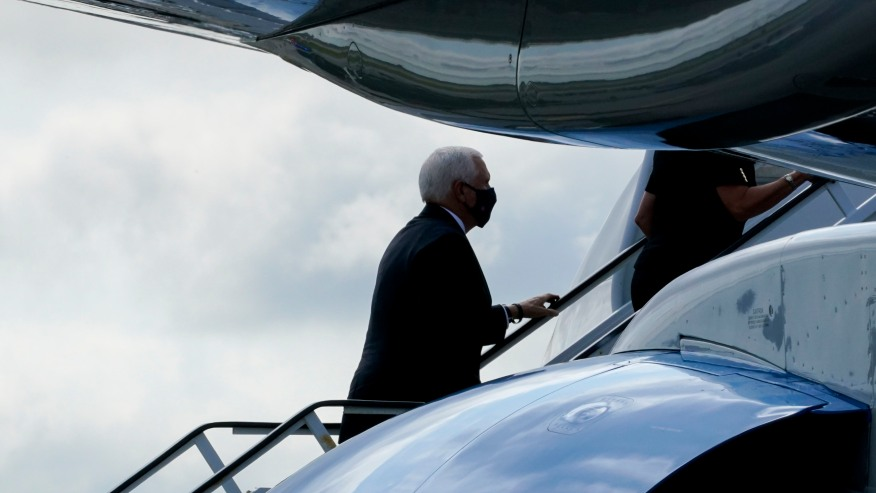 Vice President Mike Pence boards Air Force Two after attending a ceremony marking the 19th anniversary of the 9/11 terrorist attacks at the National September 11 Memorial & Museum, Friday, Sept. 11, 2020, in New York. (AP Photo/Mary Altaffer)